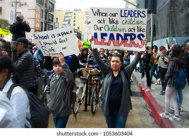 Los Angeles, California - March 24, 2018: March for Our Lives movement with protesters demanding Washington tougher gun control. People of all ages gather in Downtown Los Angeles near the City Hall.