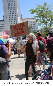 LOS ANGELES California- May 1, 2017: May Day Protest Rally Against President Donald J. Trump. People March with signs and chant slogans on May 1, 2017 in Los Angeles, California.
