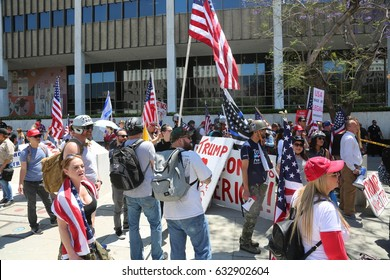 LOS ANGELES California- May 1, 2017: President Trump Supporters Wave Signs, Wear Costumes, Cheer, Smile and Laugh at a Protest Rally Against President Donald Trump on May 1, 2017