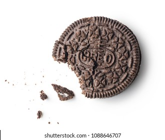Los Angeles, California May 11, 2018: Bitten cookie Oreo isolated on white background. Oreo is American famous cookies brand aka Milk's favorite cookie