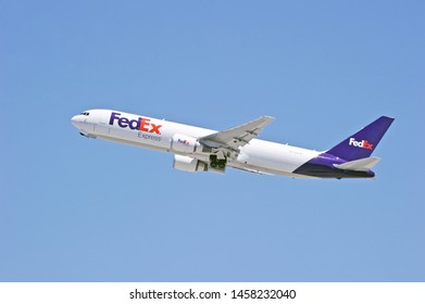 LOS ANGELES - CALIFORNIA, MAY 11, 2019: FedEx Boeing 767 aircraft is airborne as it departs Los Angeles International Airport. Los Angeles, California USA