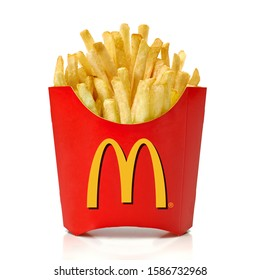 Los Angeles, California - May 17, 2019: McDonald French Fries in paper cup or package isolated on white background. McDonald Company is the most popular market leader in USA