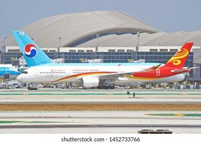 LOS ANGELES - CALIFORNIA, MAY 4, 2019: Hong Kong Airlines Airbus A350 aircraft taxiing along the runway upon arrival at Los Angeles International Airport. Los Angeles, California USA