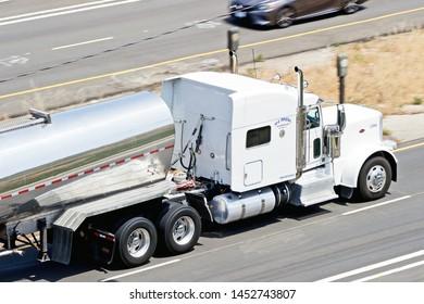LOS ANGELES - CALIFORNIA, MAY 4, 2019: Diesel liquid tanker truck cruising along the highway in Los Angeles, California USA