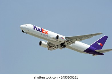 LOS ANGELES - CALIFORNIA, MAY 4, 2019: FedEx Boeing 767 aircraft is airborne as it departs Los Angeles International Airport. Los Angeles, California USA