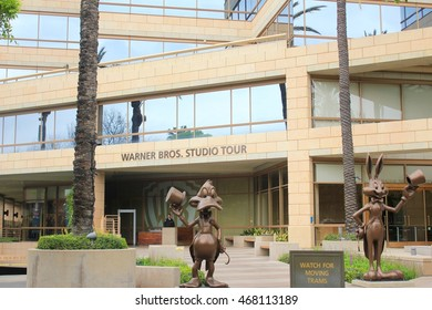 Los Angeles, California - May 6, 2016: Donald duck and Bugs Bunny figures in front of Warner Bros. Studios in California