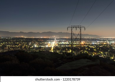 Los Angeles California predawn mountain view of powerlines entering the San Fernando Valley.  The San Gabriel Mountains are in background.