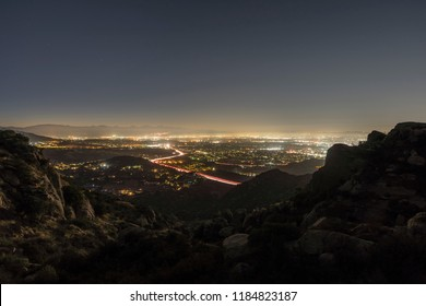 Los Angeles California predawn view of Porter Ranch and the 118 freeway in the San Fernando Valley.  Burbank, North Hollywood and the San Gabriel Mountains are in background.