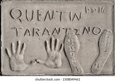 Los Angeles, California - September 06, 2019: Hand and footprints of filmmaker Quentin Tarantino in the Grauman's Chinese Theatre forecourt, Hollywood, Los Angeles, California, USA.