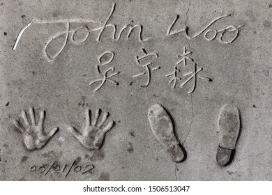 Los Angeles, California - September 07, 2019: Hand and footprints of filmmaker John Woo in the Grauman's Chinese Theatre forecourt, Hollywood, Los Angeles, California, USA.