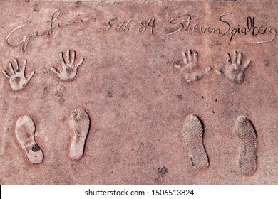 Los Angeles, California - September 07, 2019: Hand and footprints of filmmakers George Lucas and Steven Spielberg in the Grauman's Chinese Theatre forecourt, Hollywood, Los Angeles, California, USA.