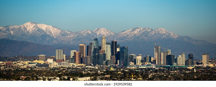 Los Angeles California taken on January 30, 2021. Downtown Los Angeles with snow capped mountains.