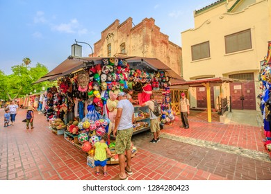 Los Angeles, California, United States - August 9, 2018: tourists go shopping in Olvera Street, the oldest part of downtown LA, at El Pueblo in Los Angeles State Historic Landmark since 1953.