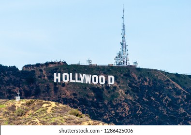 Los Angeles, California, United States of America - January 8, 2017. The Hollywood Sign on Mount Lee in the Hollywood Hills area of Santa Monica Mountains, with telecom tower.