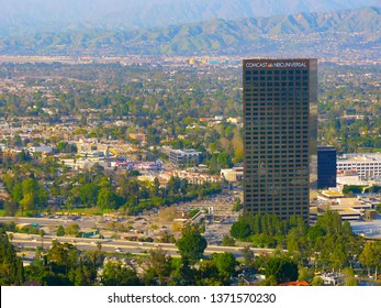 Los Angeles, California, United States – April 16, 2019: Comcast NBC Universal office building. NBCUniversal sign. Rooftop name on the building at shiny summer day. Mountains view.