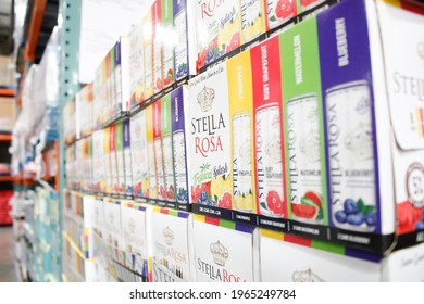 Los Angeles, California, United States - 04-06-2021: A view of several boxes of Stella Rosa Tropical Splash wine cans, on display at a local big box grocery store.