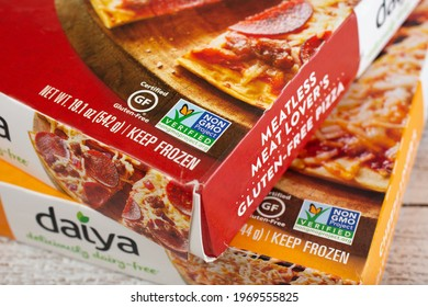 Los Angeles, California, United States - 04-26-2021: A closeup view of the Non GMO Project Verified logo on the corner of frozen Daiya pizza boxes.