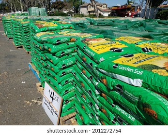 Los Angeles, California, United States - 07-15-2021: A view of several large bags of Miracle-Gro garden soil products, on display at a home improvement parking lot.