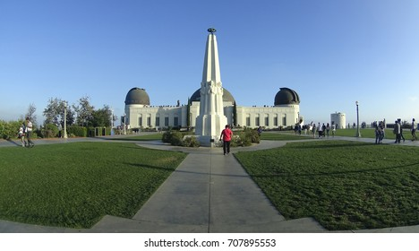 Los Angeles, California, USA - 05.29.2017: Griffith observatory with the statue in front, shot from the axle.