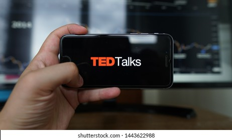 Los Angeles, California, USA - 06 Jule 2019: A hand holding Apple iPhone with shows icon TED talk application,TED talk is a popular application video icon talking about for people.