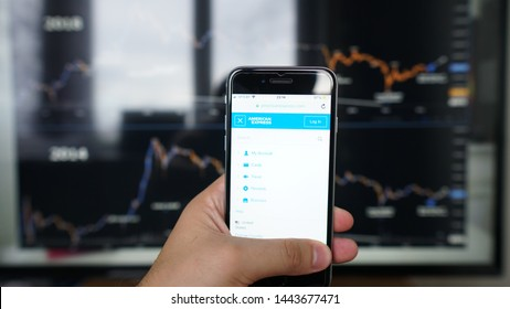 Los Angeles, California, USA - 06 July 2019.Illustrative Editorial of American Express Company website homepage. American Express Company logo visible on the phone screen.