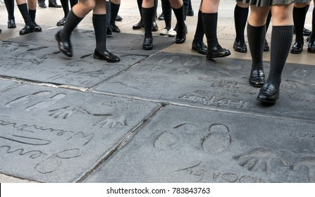 Los Angeles, California, USA 12, 2017: Group of students traveler walking on the footprints of Hollywood legends at Graumans Chinese Theater in Holywood, Los Angeles, California USA.