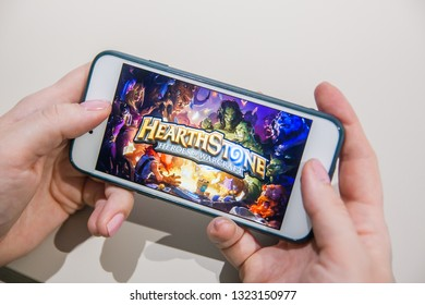Los Angeles, California, USA - 25 February 2019: Hands holding a smartphone with Hearthstone intro on display screen