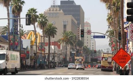 LOS ANGELES, CALIFORNIA, USA - 7 NOV 2019: Walk of fame promenade, Hollywood boulevard in LA city. Pedastrians walking on sidewalk of street. Entertainment and cinema industry iconic tourist landmark.