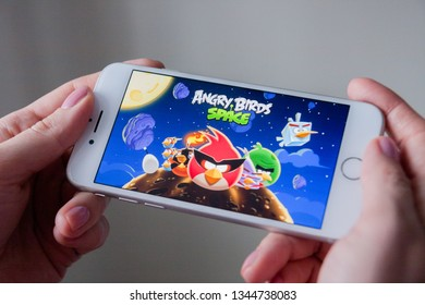 Los Angeles, California, USA - 8 March 2019: Hands holding a smartphone with Angry Birds Space game on display screen, Illustrative Editorial