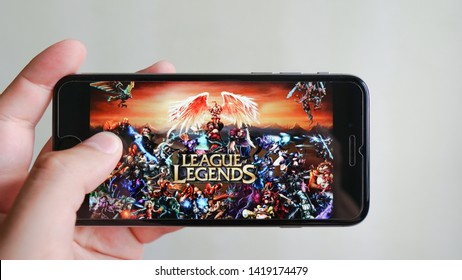 Los Angeles, California, USA - 9 June 2019: Hands holding a smartphone with League of Legends game on display screen, Illustrative Editorial