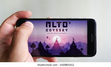 Los Angeles, California, USA - 9 June 2019: Hands holding a smartphone with  Alto's Odyssey game on display screen