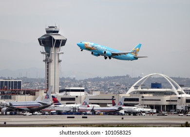 LOS ANGELES, CALIFORNIA, USA - APRIL 24: An Alaska Airlines Magic of Disneyland 737-400 takes off from Los Angeles Airport on April 24, 2012.  It has a range of 2,370 miles and 144 seats.