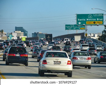 "Los Angeles, California USA – April 20, 2018: It's a slow drive with increasing rush hour traffic on Interstate 405, locally called ""the 405"" or San Diego Freeway, approaching downtown LA."