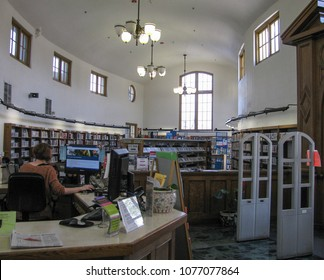 Los Angeles, California USA - April 5, 2018: Interior view of Lincoln Heights Carnegie Library includes central checkout desk, curved walls and clerestory windows.