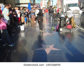 LOS ANGELES, CALIFORNIA / USA - APRIL 06, 2015: Street Dancer Boy Performing Michael Jackson Boy in Michael Jackson Suit and Dancing on the Street in Hollywood Walk of Fame