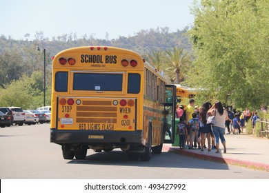 Los Angeles, California, USA - April 20, 2016: School Bus is dropping off students and teachers at a zoo for the school trip.