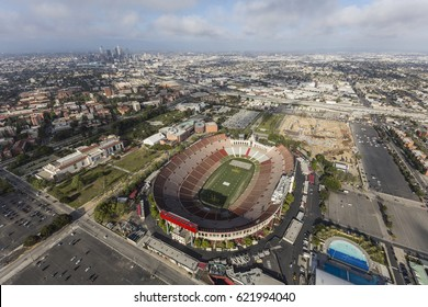 Los Angeles, California, USA - April 12, 2017:  Aerial view of the historic Coliseum stadium with downtown in background.