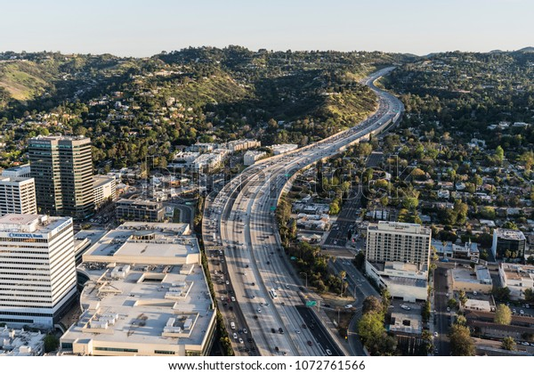Los Angeles, California, USA - April 18, 2018:  Late afternoon aerial view of 405 Freeway and Sepulveda Pass in the San Fernando Valley.