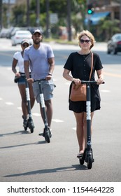 Los Angeles, California / USA - August 11, 2018: Electric scooters for hire become popular mean of private transportation in big cities. They are convenience and hip rides for all ages.