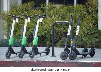 Los Angeles, California / USA - August 11, 2018: Electric scooters for hire become popular mean of transportation for domestic and visitors. They are convenience and hip ride for all ages.