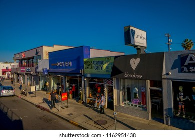 Los Angeles, California, USA, AUGUST, 20, 2018: Unidentified people walking in the sidewalk close to a clothes stores in Santa monica avenue in a gorgeous sunny day and blue sky