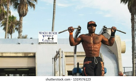 LOS ANGELES, CALIFORNIA, USA - AUGUST 25, 2015: close up of a bodybuilder performing slow controlled pullups