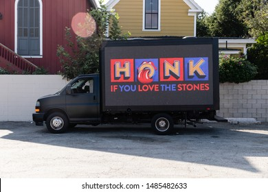 Los Angeles, California / USA - August 22, 2019: Rolling Stone truck coming from the tailgate party. In a big LED screen it says, Honk if you love the stones. Concert at the Rose Bowl in Pasadena, Ca.