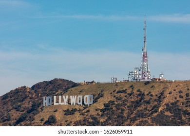 """Los Angeles, California, USA - August 2019: Los Angeles is an extensive city in southern California, the center of the United States television and film industry. Icons are the """"Hollywood"""" sign and th"""