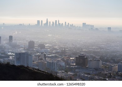 Los Angeles, California, USA - December 16, 2018:  Foggy morning cityscape view of Hollywood and downtown LA from hilltop.