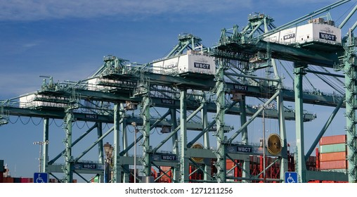 Los Angeles, California USA - December 30, 2018: A row of gantry cranes at a commercial shipping terminal in the Port of Los Angeles loads and unloads container ships.