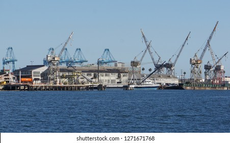 Los Angeles, California USA - December 30, 2018: Abandoned shipyard with gantry cranes and empty warehouse buildings once loaded and unloaded cargo from ships in the Port of Los Angeles
