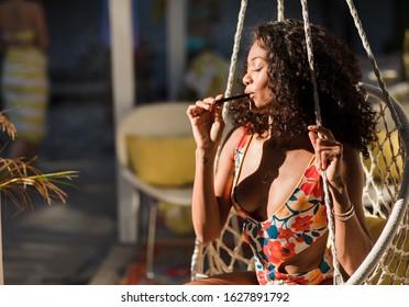 Los Angeles, California / USA -December 12, 2019: 420 friendly pool party gathering smoking vape pens