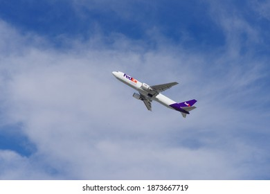 Los Angeles, California, USA - December 13, 2020: image of a FedEx Boeing 767 shown departing from the Los Angeles International Airport, LAX.