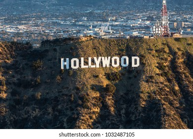 Los Angeles, California, USA - February 20, 2018:  Morning aerial view of the famous Hollywood Sign in Griffith Park with Burbank in background.